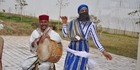 Street performers welcome cruise ship passengers from the MSC Preziosa into Tunis.