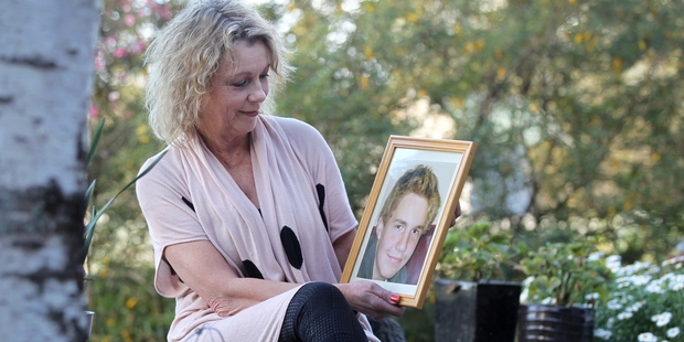 Cherie Adams with a photo of her son Corey, who committed suicide on June 20, 2011. Photo / Duncan Brown