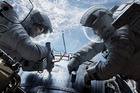 Sandra Bullock as Dr Ryan Stone and George Clooney as Matt Kowalsky in Gravity, which has earned rave reviews. Photo / AP