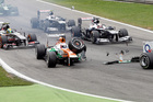 Great Britain's Paul Di Resta crashes his Force India during the first lap at the Italian Grand Prix, at the Monza Formula One circuit, in Monza, Italy. Photo / AP