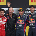 Red Bull driver Sebastian Vettel of Germany, center, winner, celebrates on the podium with Red Bull technical director Adrian Newey,second place Fernando Alonso, and third place Mark Webber. Photo/AP