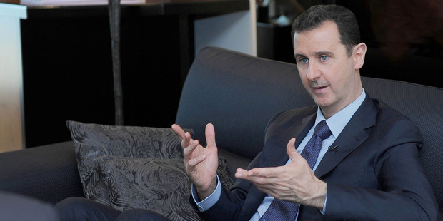 Syrian President Bashar Assad says he'll destroy his chemical weapons - but only if threats of military action from the US cease. Photo / AP
