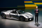 Porsche AG CEO Matthias Mueller presents the new Porsche 918 Spyder during a preview by the Volkswagen Group prior to the 65th Frankfurt Auto Show.