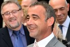 British actor Michael Turner, who uses the stage name Michael Le Vell, smiles as he speaks to the media outside Manchester Crown Court. Photo / AFP