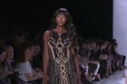 Naomi Campbell gets the crowd going at New York Fashion Week, wearing the finale look at Diane von Furstenberg's oasis-themed show.