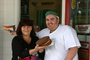 Stanford House RN Marie White with Cameron Butchart outside Butcharts Home Cookery in Gonville. An award-winning baker, Cameron is a guest judge supporting the Cake Bake Off. Photo / SUPPLIED