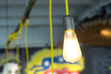 Bare bulbs with yellow flex at Elizabeth Cafe Larder in Tauranga. Photo / Ben Crawford