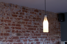 Milk bottle lights hanging in Dunedin's Dieseline cafe. Photo / Ben Crawford