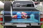 A Waco, Texas, advertising company is selling this tailgate decal of a woman tied up and unconscious as part of its range. It didn't go down well.