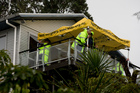 Police at the scene of the property on Takahe Road, Titirangi, West Auckland. Photo / NZ Herald