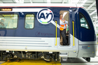 Driver William Els with the first of Auckland's faster, safer and more comfortable new trains. Photo / Richard Robinson