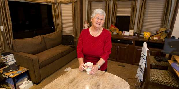 Noeleen Faulkner's RV has a double bed, a two-seater fold-out couch, a 40-inch TV, and a full kitchen and separate bathroom. Photo / Greg Bowker