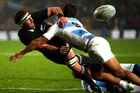 Kieran Read offloads after a Juan Manuel Leguizamon tackle on Saturday night. Photo / Getty Images