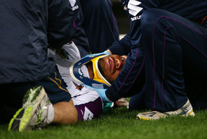 Storm winger Sisa Waqa receives medical attention. Photo / Getty Images