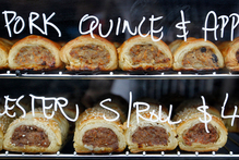Pies and sausage rolls on sale from Urban Bounty. Photo / Christine Cornege