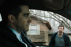Jake Gyllenhaal, left, and Hugh Jackman in a scene from Prisoners.