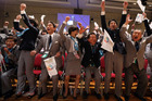 Shinzo Abe, second right, and other members of the Japanese delegation are delighted with the decision. Photo / AP