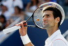 Novak Djokovic, of Serbia, looks up into the grandstand before serving to Stanislas Wawrinka, of Switzerland, during the semifinals of the 2013 U.S. Open tennis tournament. Photo / AP