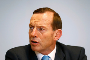 Abbott said the new micro-parties, as well as Labor and the Greens, should abide by the mandate Australian voters gave the new Government. Photo / AP