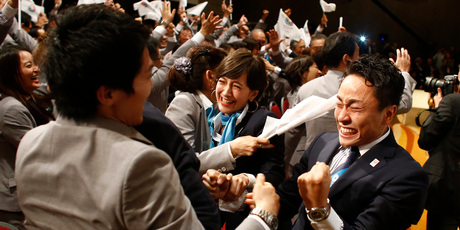 Members of the Tokyo delegation celebrate beating Istanbul and Madrid for the honour. Photo / AP