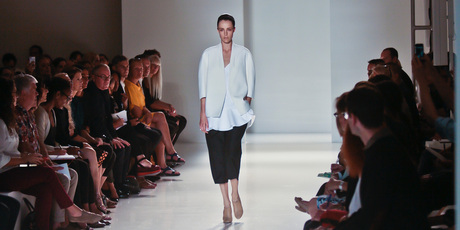 Victoria Beckham opened the show opened with a white round-shouldered blazer paired with loose, cropped black pants.Photo / Bebeto Matthews