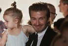 David Beckham and two-year-old daughter, Harper, steal the show.Photo / Bebeto Matthews