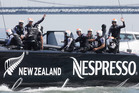 The crew on Emirates Team New Zealand wave to cheering spectators after one of the wins, but will they get a chance to race tomorrow? Photo / AP