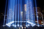 The Tribute in Light rises above buildings in lower Manhattan during a test for today's ceremony. Photo / AP