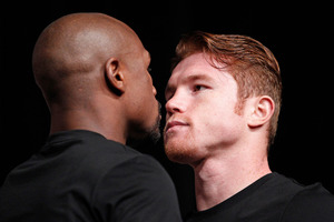Floyd Mayweather Jr (left) and Saul Alvarez face off ahead of the big fight. Photo / AP
