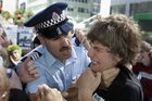 A police sergeant holds a protester in a neck grip during a protest in Auckland against the occupation of Iraq. Photo / Herald on Sunday
