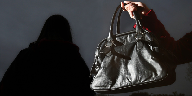 A man and a woman have been accused of allegedly snatching a couple's bags.