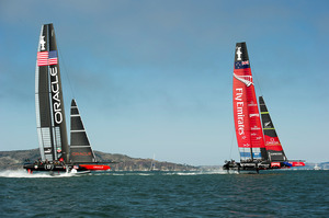 Emirates Team New Zealand leads Oracle Team USA down the first run in race seven on day four of the America's Cup 34. 12/9/2013. Photo / File.