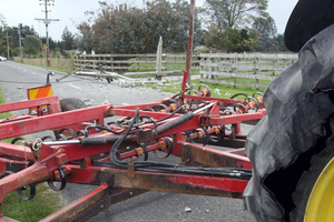 A tractor and cultivator took down a powerpole on Upper Manaia Road, Masterton. Photo / Lynda Feringa