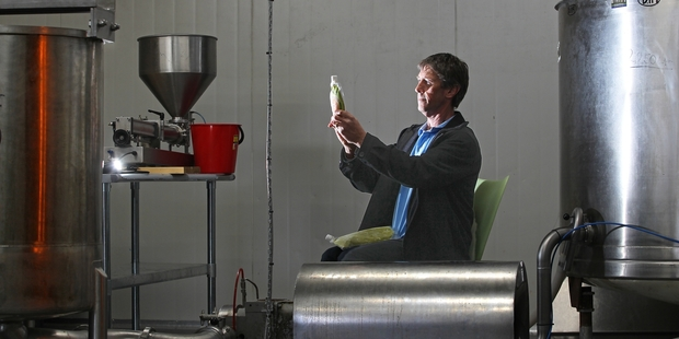 Colin Elder inspects the product at his new production facility in Tauranga. Photo / John Borren