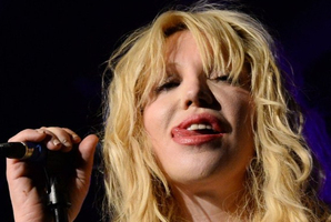 Courtney Love sticks her tongue out as she performs at Vinyl. Photo / AFP