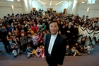 David Ock-Youn Jang with his congregation, who say they trust him and are standing by him. Photo / Brett Phibbs