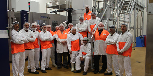 Frucor staff in front of the new equipment installed at the Manukau plant.