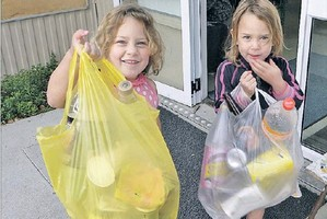 BIG MINIMISERS: OceanaWilkins-Chadwick (with yellow bag) and Acacia Wilkins-Chadwick (white bag) of Camberley Kindergarten know the value of recycling - and they have a Keep New Zealand Beautiful Beverage Container Recycling Project to prove it.
