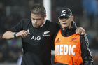 Richie McCaw is helped off the field after suffering a knee injury against Argentina. Photo / Getty Images