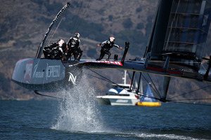 Emirates Team New Zealand, skippered by Dean Barker, in action against Oracle Team USA. Photo / Getty Images