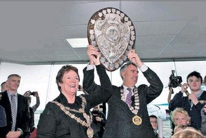 STUCK ON IT: Napier and Hastings mayors Barbara Arnott and Lawrence with the shield - minus two of the crests.