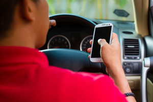 "The driver played an evenly matched game of ""lookie roadie, lookie phonie"". Photo / Thinkstock"