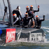 Emirates Team New Zealand skipper Dean Barker, and his team wave to the supporters after beating Oracle in Race 11 of the America's Cup. Photo / Brett Phibbs