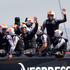 Emirates Team New Zealand skipper Dean Barker, and Rob Waddell wave to the supporters after beating Oracle in Race 11 of the America's Cup. Photo / Brett Phibbs