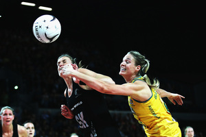 Leana de Bruin of the Silver Ferns competes with Caitlin Bassett of the Diamonds for the ball. Photo / Getty IMages