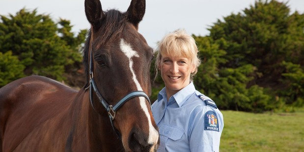 Police prosecutor Sergeant Rachel Willemsen with Hunter the horse.