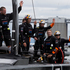 Oracle team USA wave to supporters after beating Emirates Team New Zealand to win Race 13 of the America's Cup. Photo / Brett Phibbs