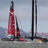 Oracle team USA heads to the finish line a head of Emirates Team New Zealand to win Race 13 of the America's Cup. Photo / Brett Phibbs