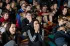 Catherine Stone (right) and a horde of spectators are horrified at Team New Zealand's near-capsize. Photo / Brett Phibbs