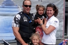 Team New Zealand crewman Chris McAsey and his wife Suzy with their children Brooke (foreground, with flags) and Billie in San Francisco for the America's Cup. Photo / File
